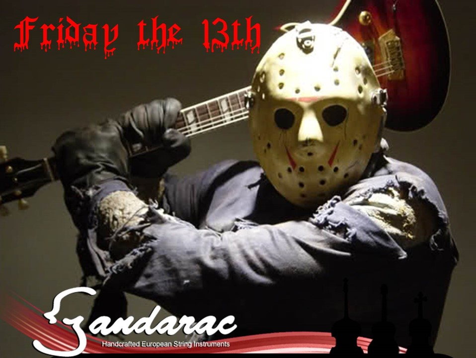 Jason from Halloween wielding a guitar